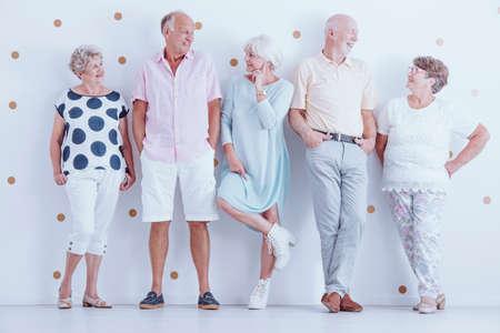 Fashion photo of happy senior friends wearing casual clothes Archivio Fotografico