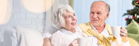 Elder marriage talking and drinking hot coffee Standard-Bild