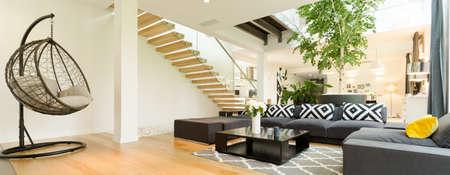 Hanging egg swing in modern spacious living room