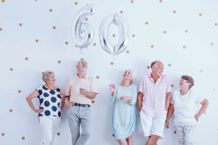 Group of elderly people have fun together during a birthday meeting