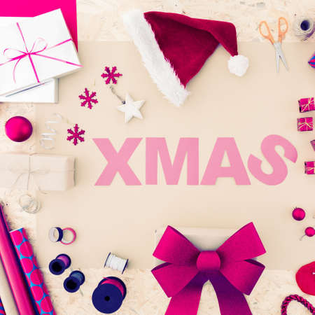 Creative christmas word with red and pink accessories