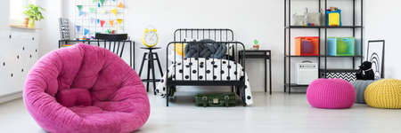 Unisex kids room with colorful decoration and metal furniture Stock Photo