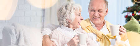 Elder couple looking lovingly at each other Stock Photo