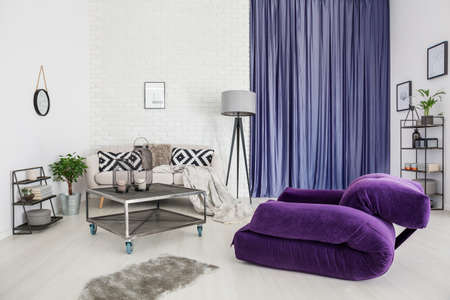Purple Armchair And Grey Rug In Modern Living Room Interior With Metal  Table In Front Of