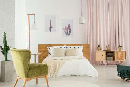 Bedroom in wild west style with velvet vintage armchair