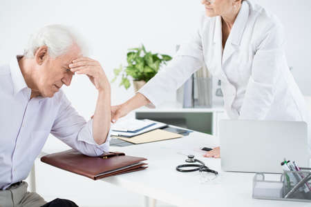General doctor examining weak outpatient at the health care center
