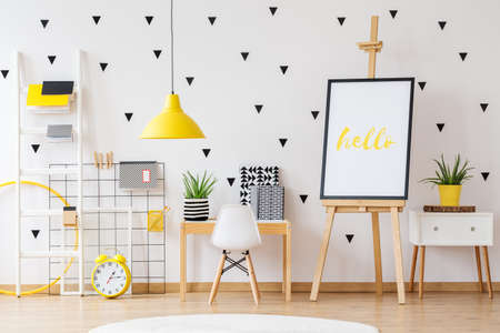 Wooden easel in white and yellow kids playing room