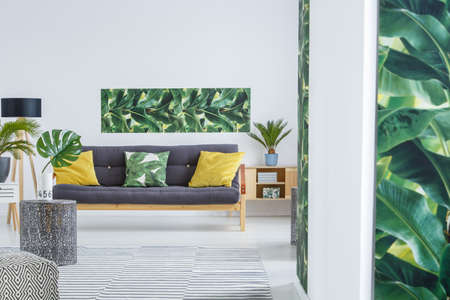 Design Kussens Bank.Yellow Cushions On Black Settee In Modern Living Room Interior