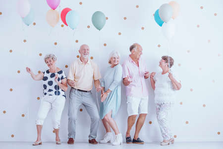 Group of pensioners dancing at a new years celebration party Reklamní fotografie