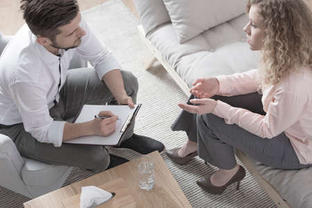 High angle of a woman consulting with a divorce lawyer