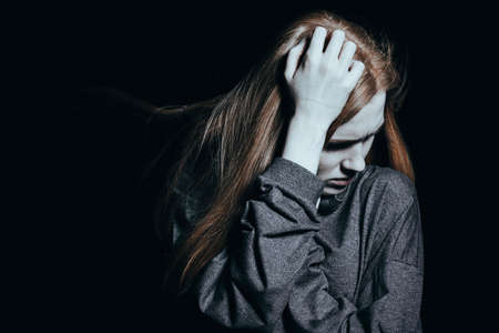 Young woman trying to deal with abandonment issues, waking up at night in terror