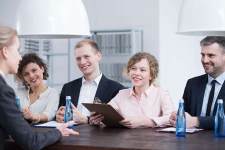 Group of smiling recruiters during a job interview with a promising candidate