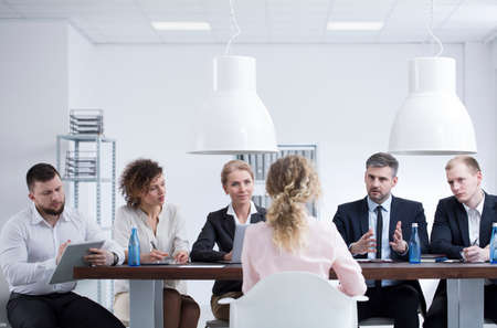Businessman asking a woman why she wants to work in the company during a recruitment meeting