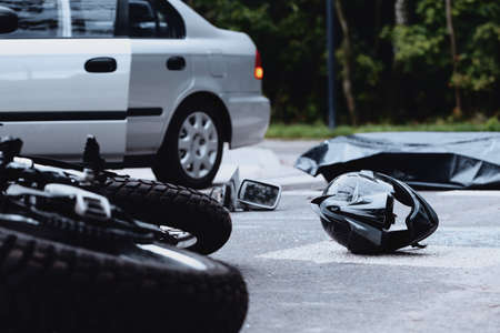 Motorcycle helmet on the street after a fatal accident with a car