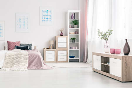 Merveilleux Stock Photo   Wooden Cabinets With Vases In Pink Bedroom Interior With Bed  Against White Wall With Blue Posters