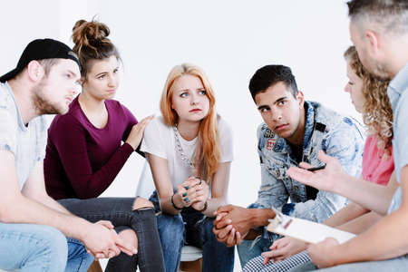 Problematic teenagers talking with a guidance counselor about future career plans Stock Photo
