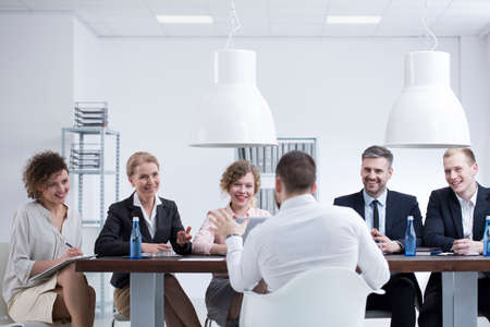 Businessman talking about an innovative idea to a group of satisfied investors Stock Photo
