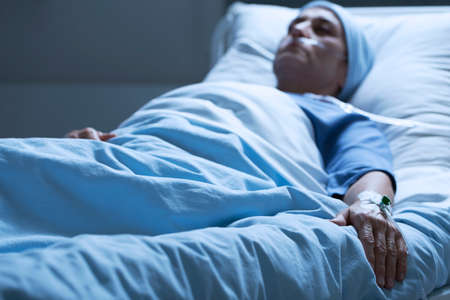 Dying woman in pain despite taking painkillers in the hospital Stock Photo