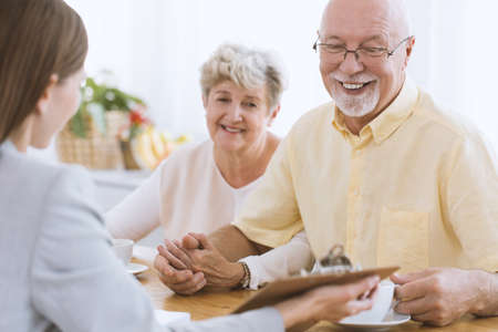 Senior people talking to a financial advisor about life insurance Stock Photo