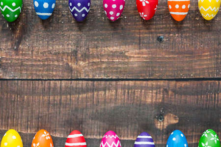Colorful easter eggs on the wooden rustic table