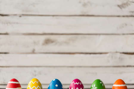 Six colorful easter eggs on a grey wooden background Stock Photo
