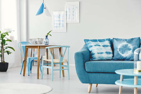Delicieux Dyed Cushions On Pastel Blue Sofa In Multifunctional Living Room Interior  With Dining Space Stock Photo