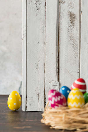 Colorful patterned easter eggs in a nest made of straw