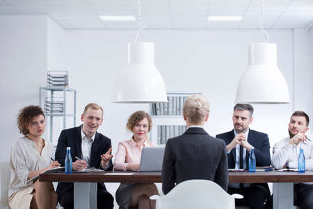 Elegant businesswoman during a job interview with a group of recruiters in corporation