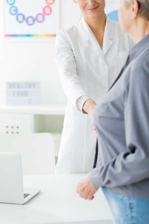 Doctor in white uniform and patient before consultation in the hospital