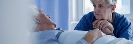 Panorama of caring wife supporting sick man with cancer in the hospital Stock Photo