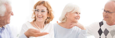 Senior couples having fun together at a nursing home talking and laughing Stock Photo