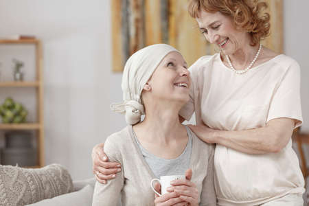 Woman with cancer celebrating disease remission with her mother
