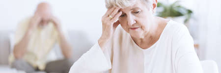 Panorama of worried and sad senior woman thinking about divorcing her husband Stock Photo