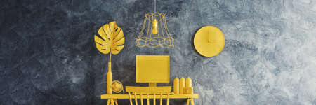 Yellow lamp above chair at desk with monstera leaf against concrete wall with clock in workspace interior