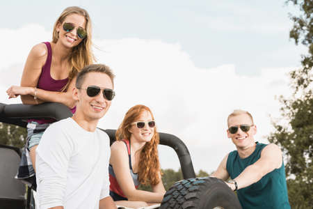 Friends spending time together in off road car