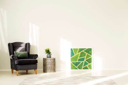 Minimalist living room interior with empty, white wall, green painting and metal table 版權商用圖片