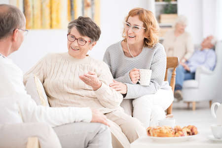 Older men and women spending time together in a rest home