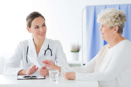 General practitioner doing a medical interview with sick patient
