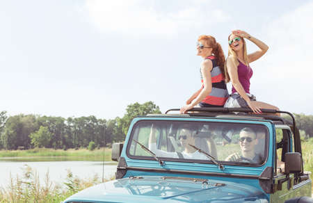 Young girls in cabriolet during car trip