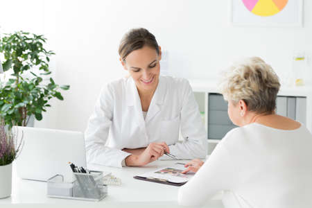 Smiling dietician and patient with nutritional problems preparing a diet plan during a meeting