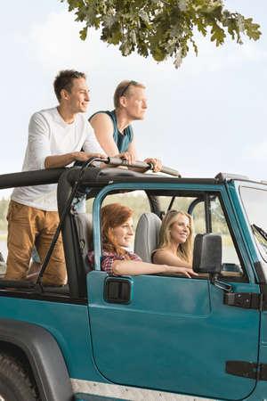 Friends enjoying the trip in cabriolet car