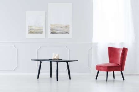High Quality Red, Vintage, Upholstered Chair With Wooden Legs And A Small, Black Coffee  Table