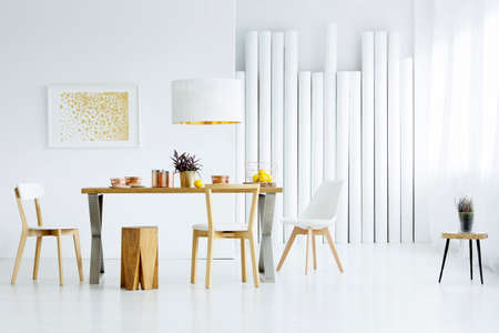 Spacious, white dining room interior with big table, chairs and tubes wall