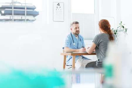 Internist and patient during medical consultation in the doctors office Stock Photo