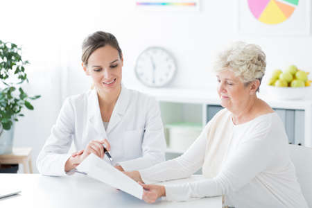 Two women sitting in a dieticians office and talking about a new diet plan. Healthy living concept