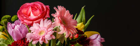 Close-up photo of colorful fresh flowers bouquet for Valentines Day on dark background