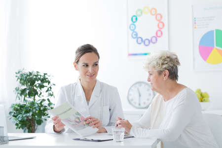 Woman sitting in a general doctors office during medical interview