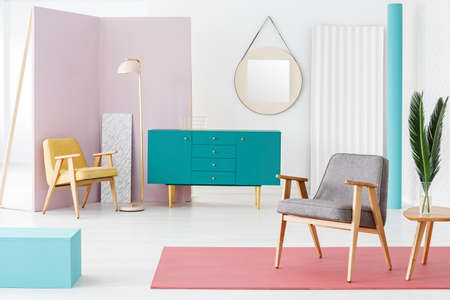 Creative, wooden furniture composition and color scheme idea for a modern, hipster living room interior with retro design elements Stock Photo