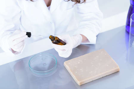 High angle of laboratory worker preparing a sample of a liquid for examination