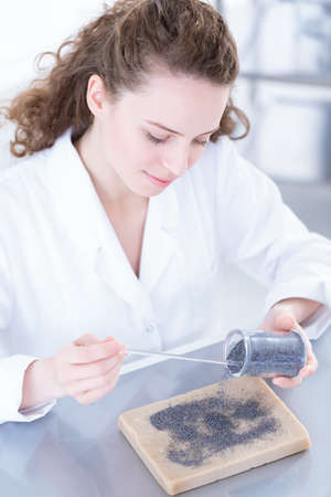Professional biotechnologist analyzing a sample of the research material